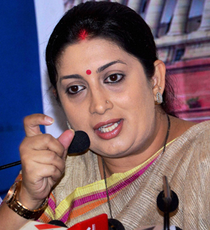 Ahmedabad: BJP leader Smriti Irani addreses a press conference in Ahmedabad on Sunday. PTI Photo (PTI3_30_2014_000062B)