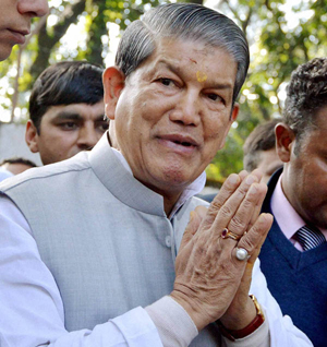 Dehradun: Union Minister Harish Rawat on his arrival in Dehradun on Saturday. Rawat has been appointed as the new Chief Minister of Uttarakhand. PTI Photo (PTI2_1_2014_000082B)