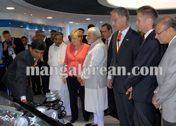 1.Dr_.-Angela-Merkel-looking-at-the-Car-Engine-at-Bosch-Factory-along-with-PM-and-CM