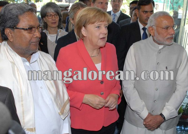 5.Dr_.-Angela-Merkel-looking-at-the-Car-Engine-at-Bosch-Factory-along-with-PM-and-CM