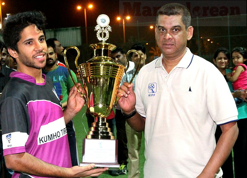3. FC Sparx captain Hussain Ali receives the Runners-up Trophy from Xavier Furtado