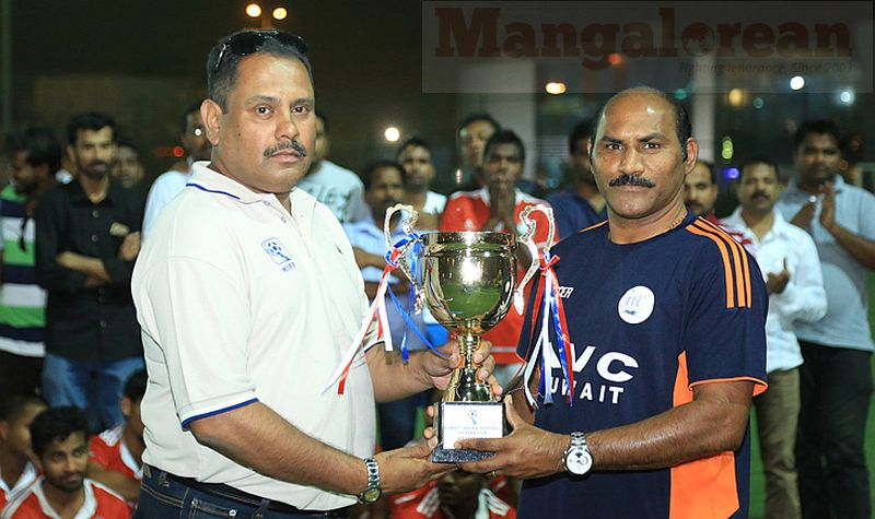 6. AVC player Vincy Pereira receiving the Fair Play Trophy from the hands of Marshall Fernandes