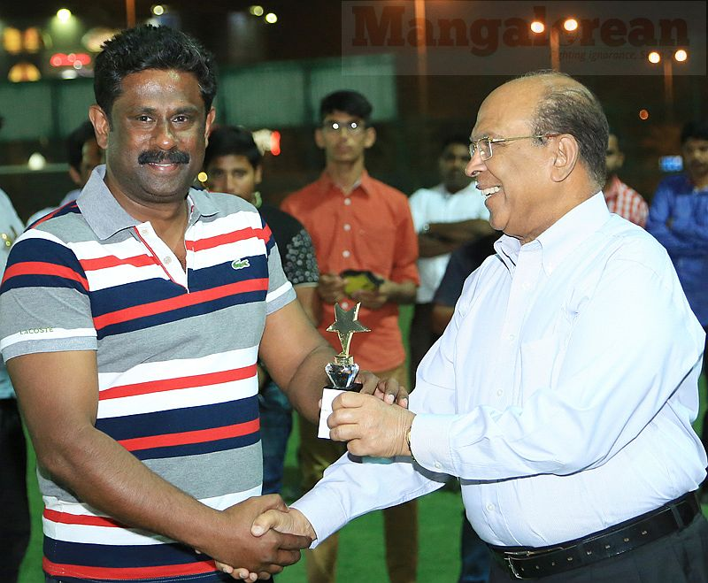 7. Soccer Kerala coach Biju Johny receives an award from Raymond D'Sa