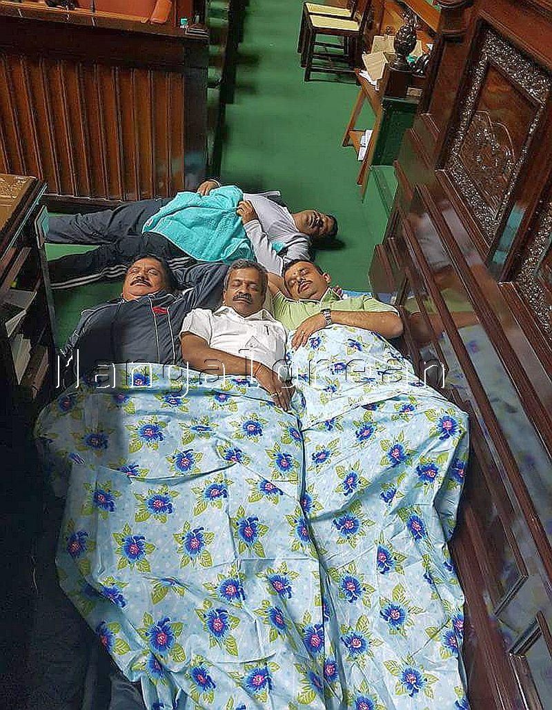 Karnataka's opposition legislators seen engaged in 'day-and-night'
